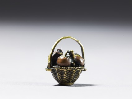 Ojime in the form of a fruit basketside