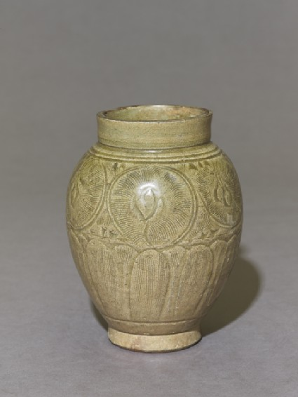 Greenware jar with lotus petals and peony scroll decorationoblique