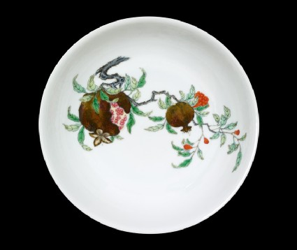 Bowl with a pomegranate spray, plum blossoms, and bambootop