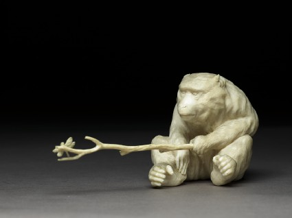 Okimono, or ornament, in the form of a monkey holding a branchside