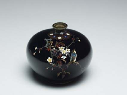 Bottle with a bird on a flowering branchoblique