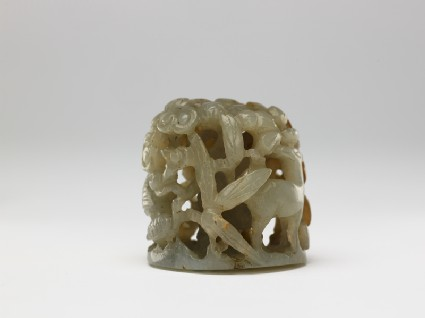 Jade finial with deer, birds, and treesside