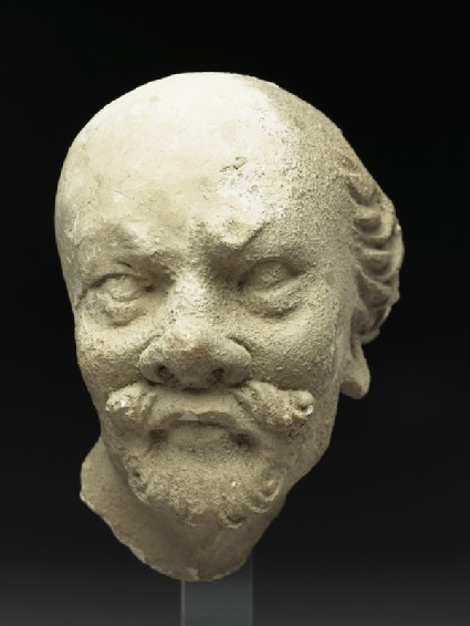 Stucco head of a manfront