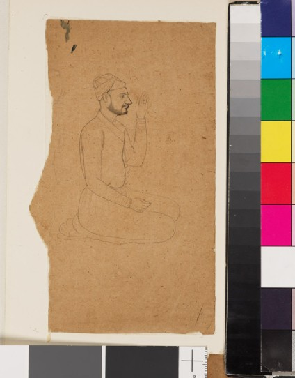 Seated man with light beard and raised handfront