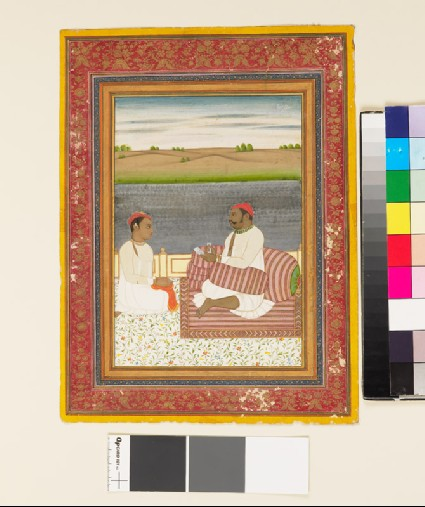 Man seated on a terrace with an attendant or pupilfront