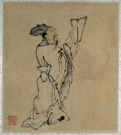 A scholar writing on a fanfront