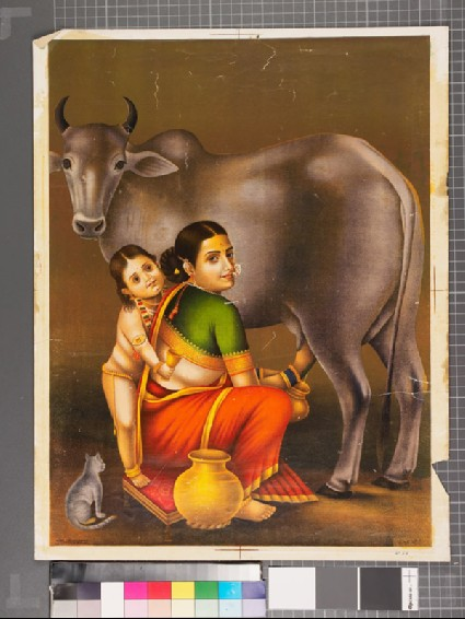 Mother and child milking the cowfront