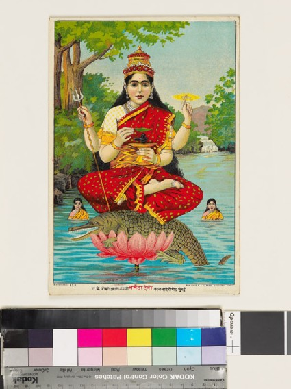 Goddess of the Narmada or Nerbudda river, holding a small stone linga and mounted on a crocodilefront