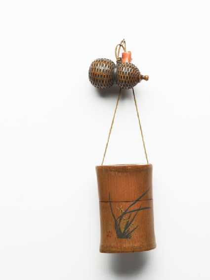 Tonkotsu, or tobacco container, attached to a gourd-shaped netsuke and an ojimefront