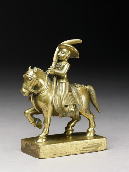 Toy soldier with horse and sabreside