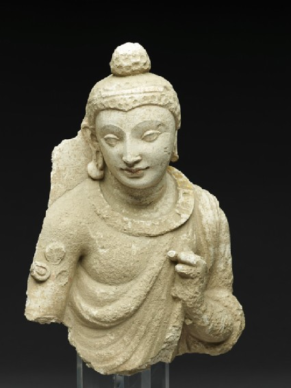 Figure of the Buddha or an attendantside