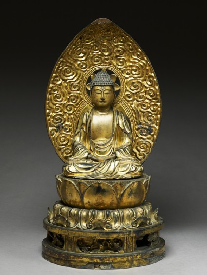 Figure of the Buddha with a mandorla, or halo, seated on a lotus pedestalfront