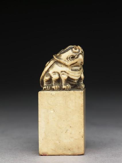 Soapstone seal surmounted by six-legged toadside