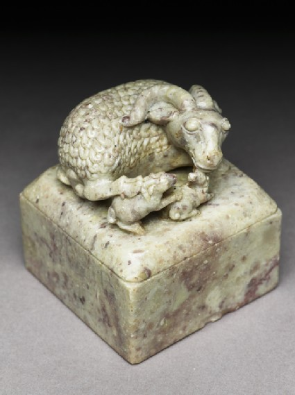 Soapstone seal surmounted by a ram and two lambsoblique