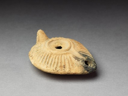 Oil lamp with moulded decorationoblique