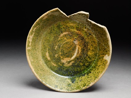 Fragment of a bowl with green glazetop