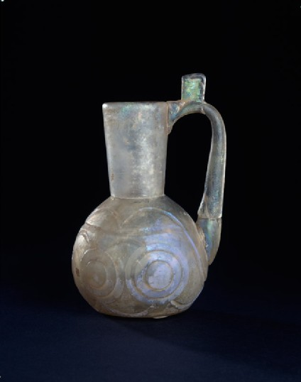 Glass jug with raised disc decorationside