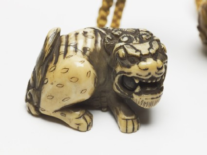 Netsuke in the form of a shishi, or lion dogoblique