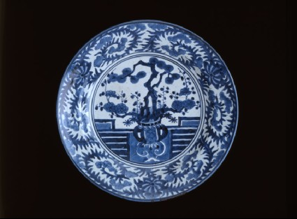 Dish depicting a vase of prunus and pinetop