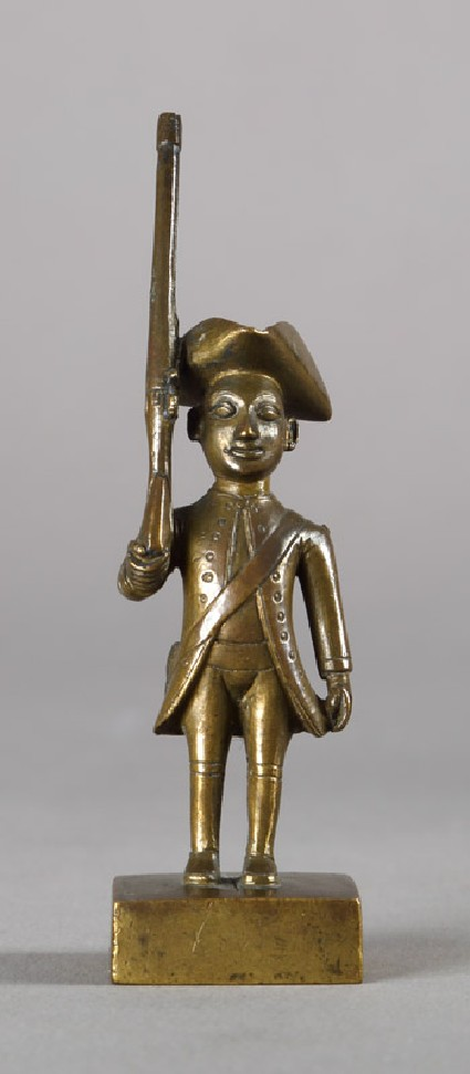 Toy European infantryman with tricorn hat and riflefront
