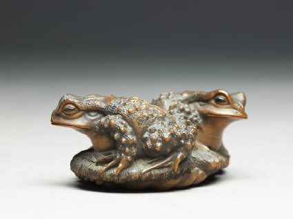 Netsuke in the form of two toads on a sandalside
