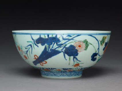 Bowl with chrysanthemums, poppies, and grassesside