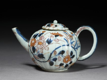 Small fluted teapot with floral decorationside