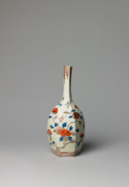Bottle with flowers and birdsside