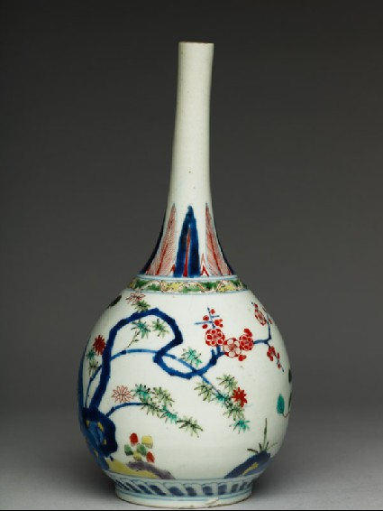 Bottle with prunus, pine, and bambooside