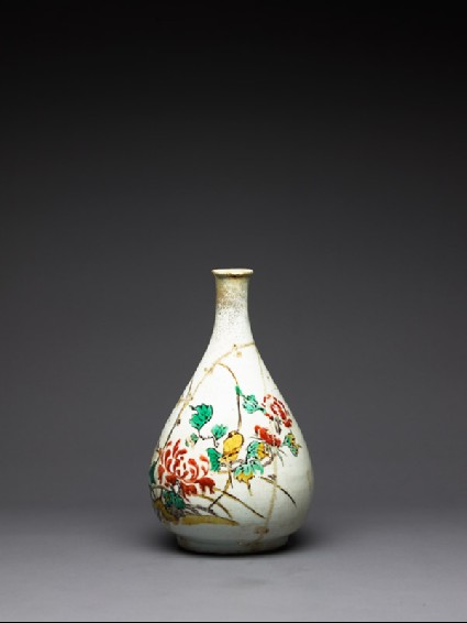 Bottle with bird amid peonies and grassesside