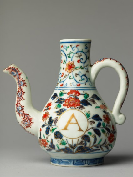 Ewer with formal flower spraysside