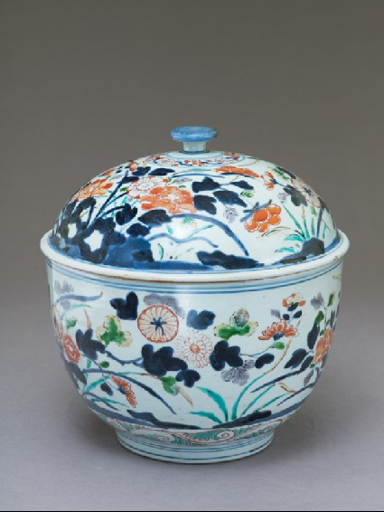 Tureen with peony and chrysanthemum growing from rocksoblique