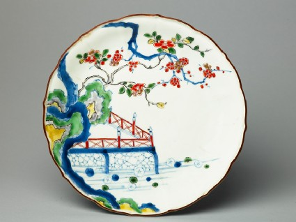 Petalled plate depicting prunus and camellia growing by a terracetop