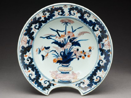 Barber's bowl depicting flowers in a vasetop