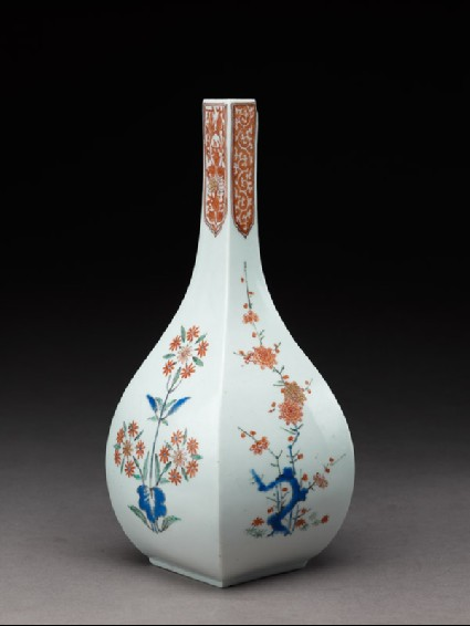 Squared bottle with prunus and formal daisy plantsside
