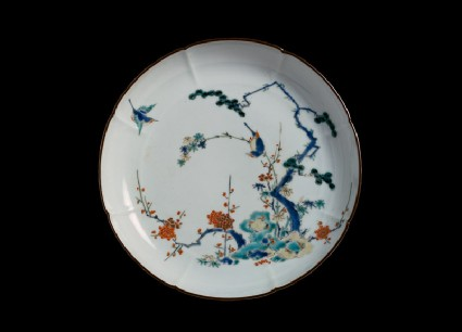Lobed plate with pine, prunus, and bamboo growing from rocksfront