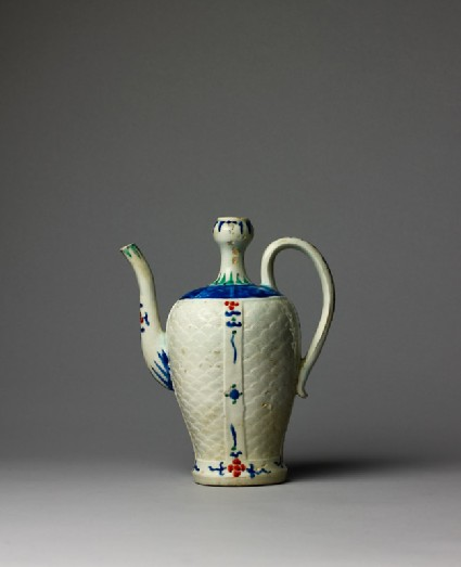 Ewer with wave pattern and stylized floral decorationside