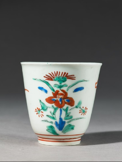 Cup with formal floral designside