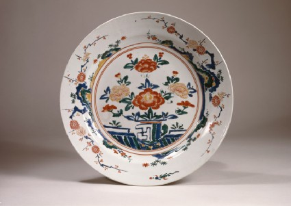 Dish with peonies on a terracetop