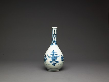Bottle with formal lotus flower and leaf spraysside