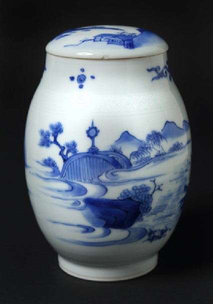 Blue-and-white jar and lid with immortal floating above a tree trunkfront