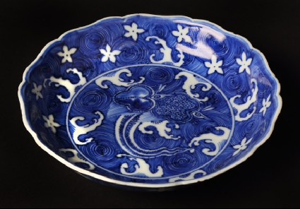Blue-and-white dish with animals amid wavesfront