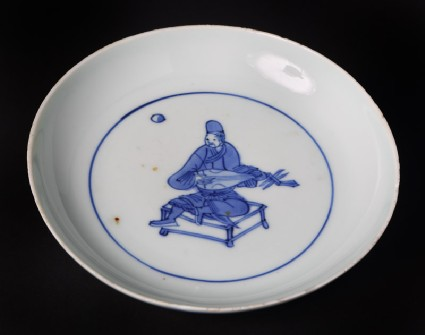 Blue-and-white dish with seated musician playing a lutefront