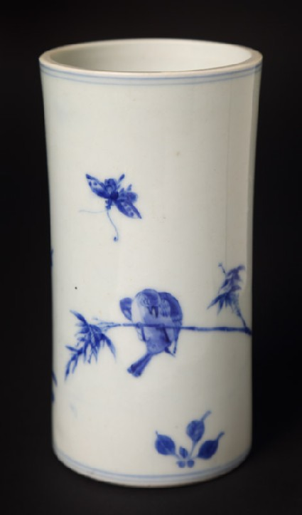 Blue-and-white brush pot with butterfly and bird on a branchfront