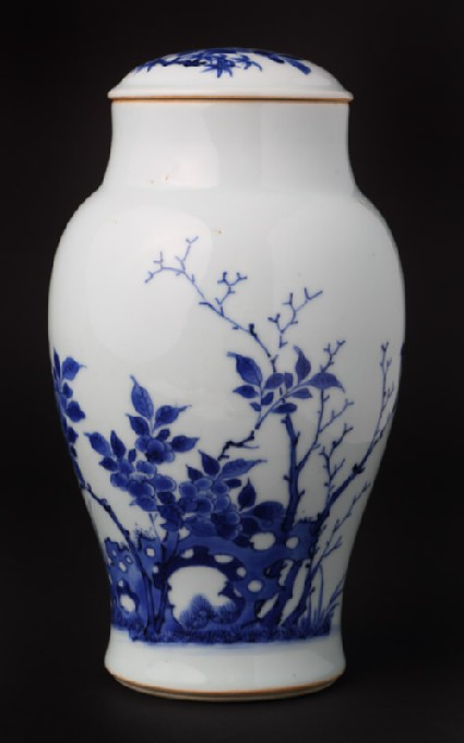 Blue-and-white jar and lid with birds, rocks, and plantsfront