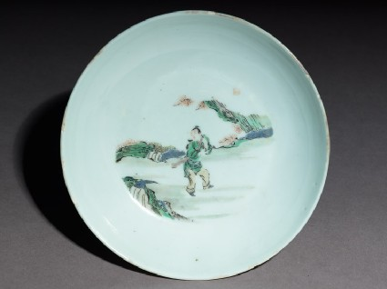 Dish with a fisherman carrying oar and a baskettop