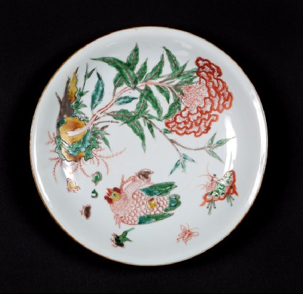 Dish with plant, hen, and six chicksfront