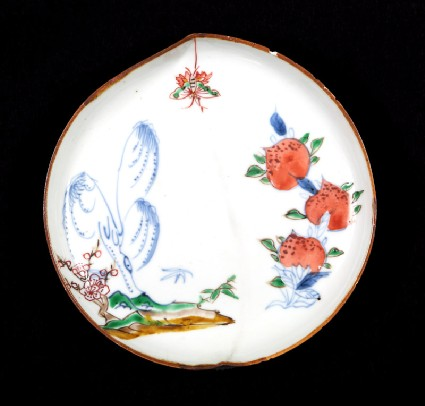 Dish in the form of a peach with willow, butterfly, and peachesfront