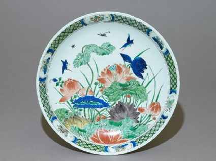 Dish with lotus plants and kingfisherstop