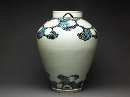 Jar with peony foliage and blossomsside